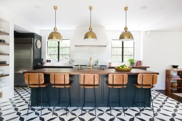 ceramic tile kitchen flooring with blue island and wood countertop