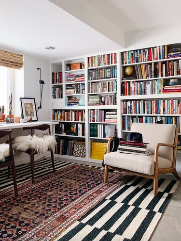 Home Office Built Ins with A wall-to-wall built-in library in a home office by Undecorated Home