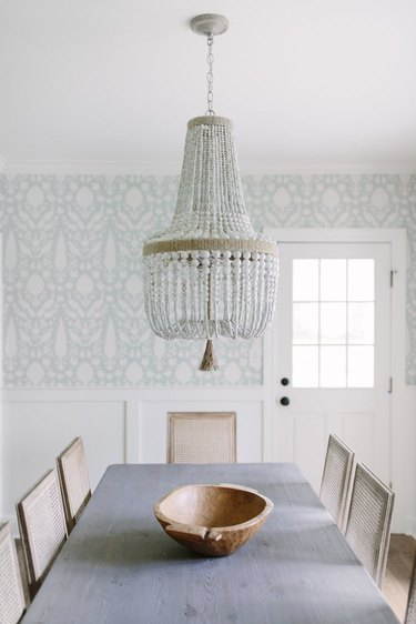 country farmhouse dining room wall idea with blue patterned wallpaper