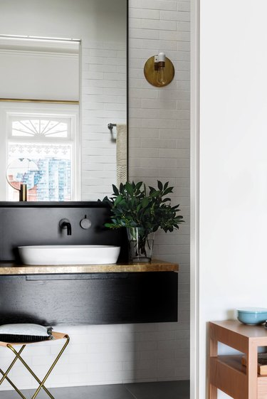 Scandinavian bathroom with shiplap wall and floating vanity