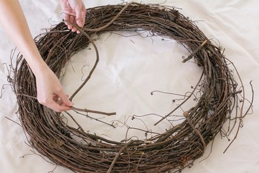 Uncoiling vine around wreath
