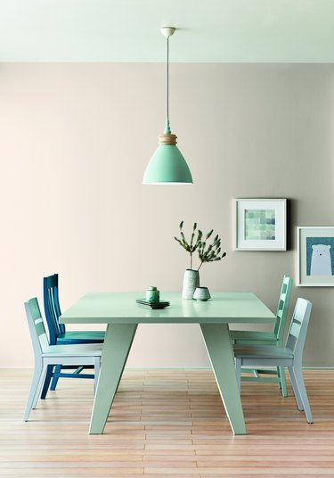 dining room space with mint furniture