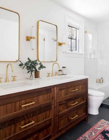 master bathroom with wood vanity