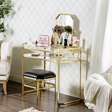 gold and glass vanity