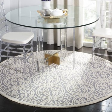 round dining room rug idea beneath round table with glass top
