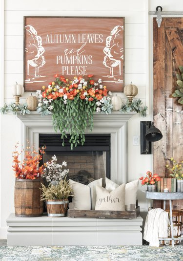 fall-inspired mantel decor with seasonal flowers and pumpkins