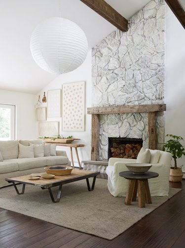 white farmhouse family room idea with paper lantern and fireplace