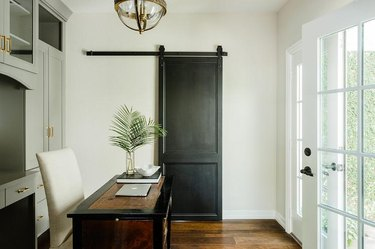 Home Office Doors with Black barn door in home office by Lauren Haskett Fine Design