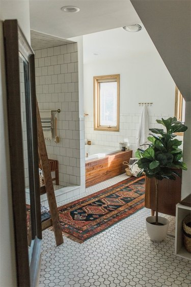 midcentury bathroom makeover with white mosaic floor tile and rug