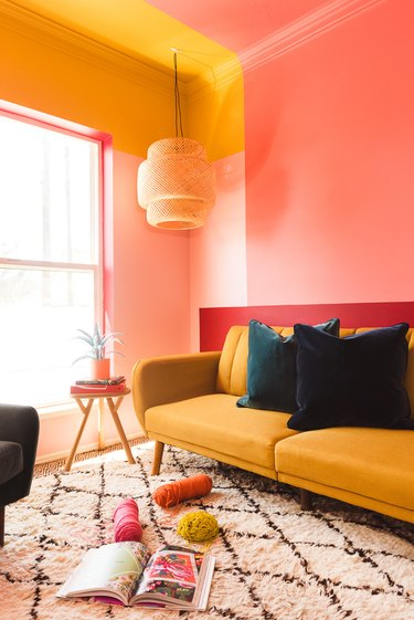 guest room with warm colors and a bamboo pendant light