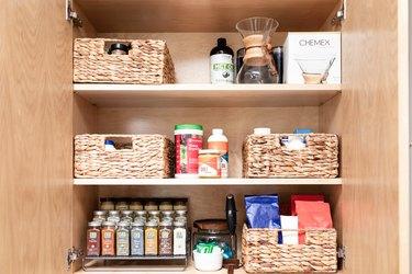 how to organize kitchen cabinet with storage baskets