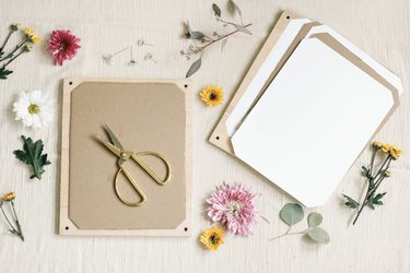 Wood board and gold scissors with flowers