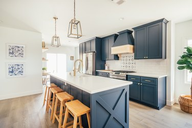 Blue kitchen cabinets in Los Angeles remodel with stove vent