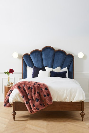 wood bed with scalloped headboard