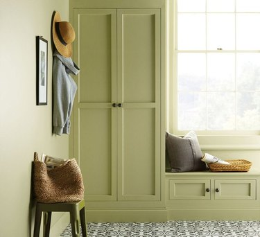 closet in green with hat hanging