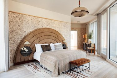 brown bedroom color idea with upholstered headboard
