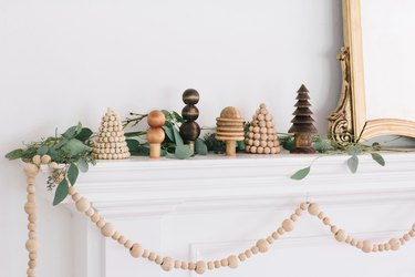Christmas mantel with wooden forest trees