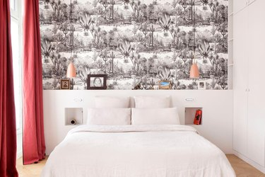 black and white bedroom color idea with wallpaper and red curtains
