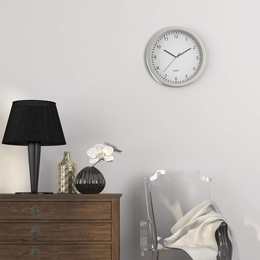 Wall clock with hidden storage