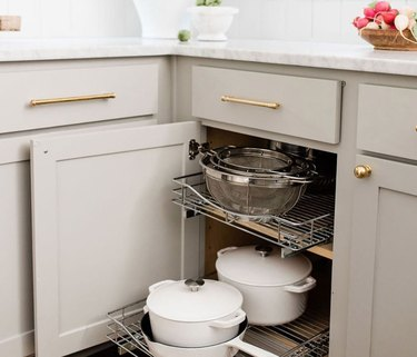 how to organize kitchen cabinets with pull out shelves