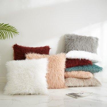 Better Homes & Gardens Mongolian Faux Fur Pillows, $12.87-$15.87