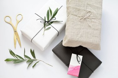 Gift wrap ideas using fabric and foliage