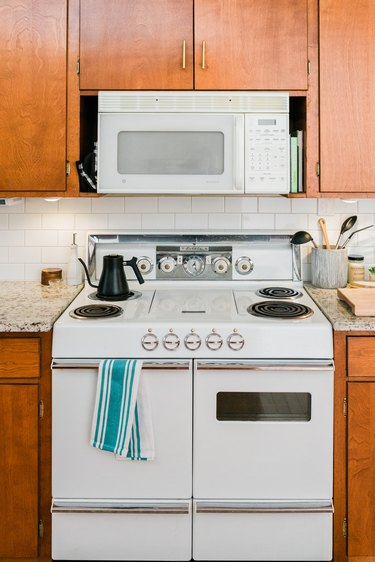 White electric stove in midcentury kitchen