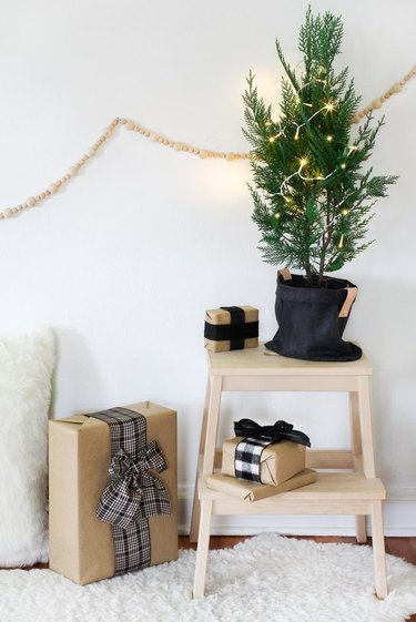 DIY waxed canvas plant holder with evergreen tree