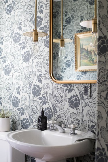 floral patterned wallpaper with brass pendant light