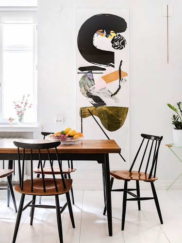 Scandinavian dining room idea with white flooring and wood table with wood chairs