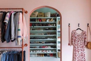 DIY Closet Organizer Ideas in pink and aqua dressing room with shoe shelving