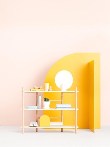shelving system near yellow room divider