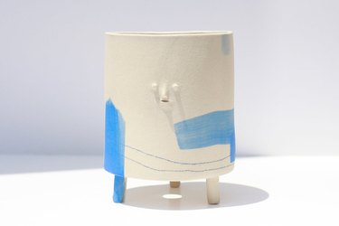 planter with legs and face