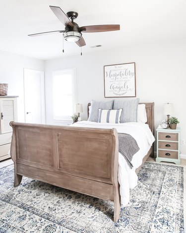 farmhouse bedroom with weathered wood bed frame