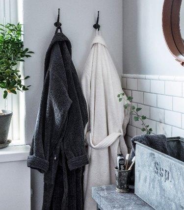 bathrobes hanging in bathroom
