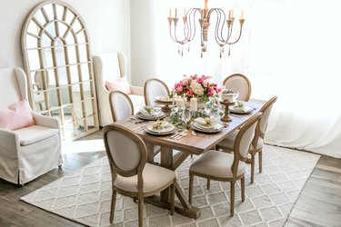 A French country dining room with greige walls