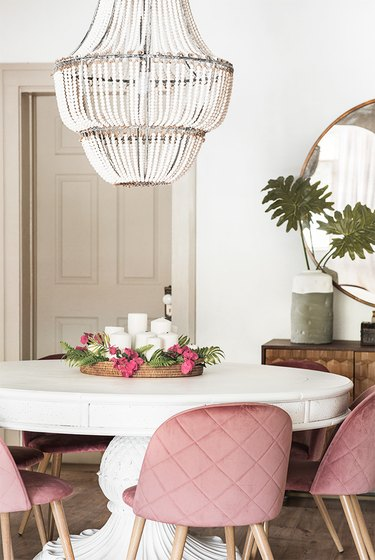 Greige trim and white walls with a round dining table