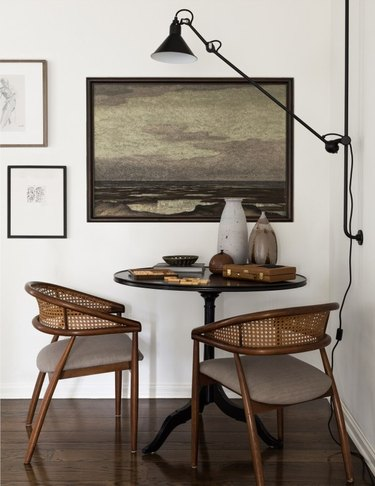 dining room table idea for small space with room for two chairs and wall-mounted light fixture