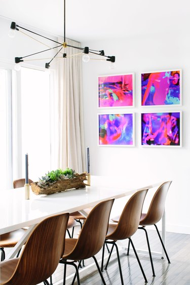 modern dining room table idea with wood chairs and contemporary light fixture above