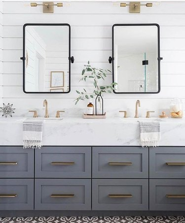glam bathroom with thick marble countertop