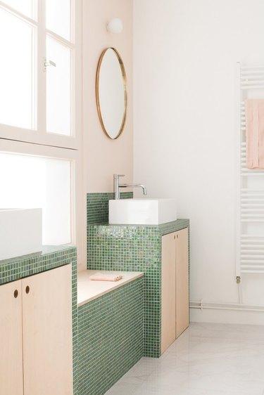 contemporary bathroom with green tile countertop
