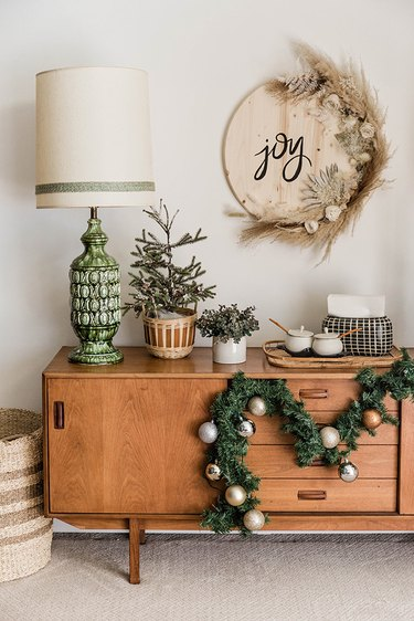 """Hang the finished """"Joy"""" sign up on the wall."""