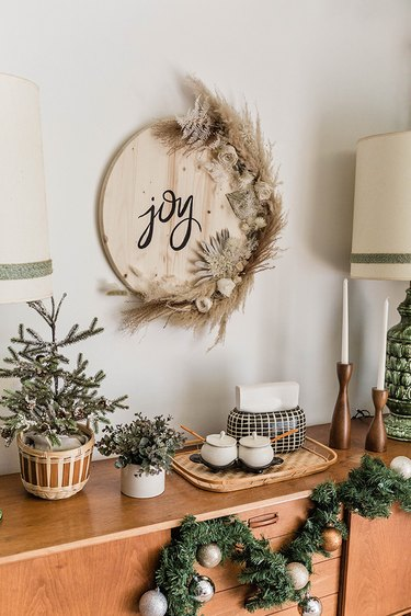 Our DIY dried florals Christmas sign is an earthy way to add festive flair to your holiday décor.