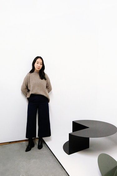 person standing near table