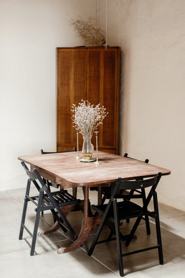 Minimal California dining room with wood storage cabinet