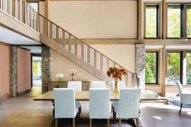 dining area and staircase featuring ppg paint's color palette of the year