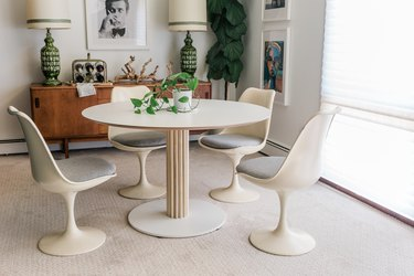 Midcentury modern dining room with white table and chairs