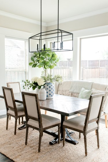 Greige dining room with tufted bench