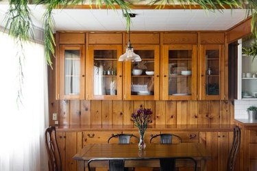 dining room with wood cabinets and dark able
