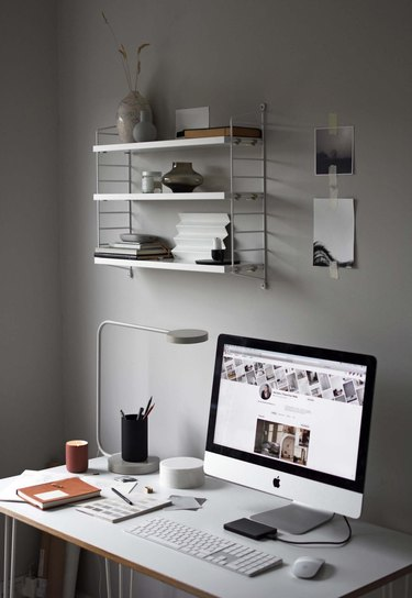 Feng Shui Home Office with light gray walls and wall shelf